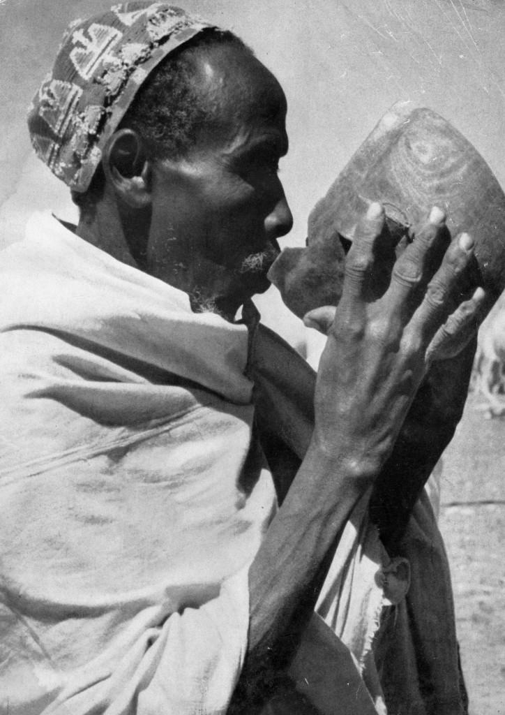 Somali nomad drinking camel milk